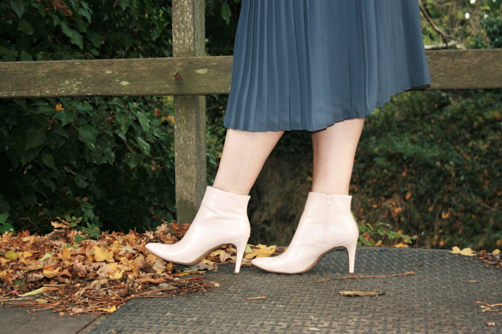 Image showing a close-up of the pink patent boots worn by Mummabstylish blogger Jacqui Berry