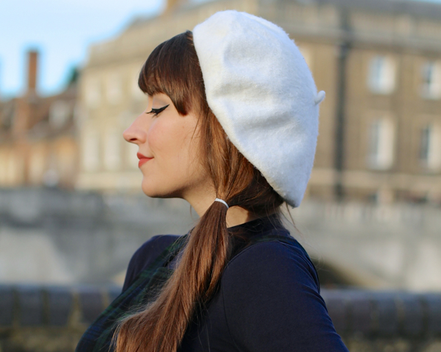 1960s mod style side ponytail with beret