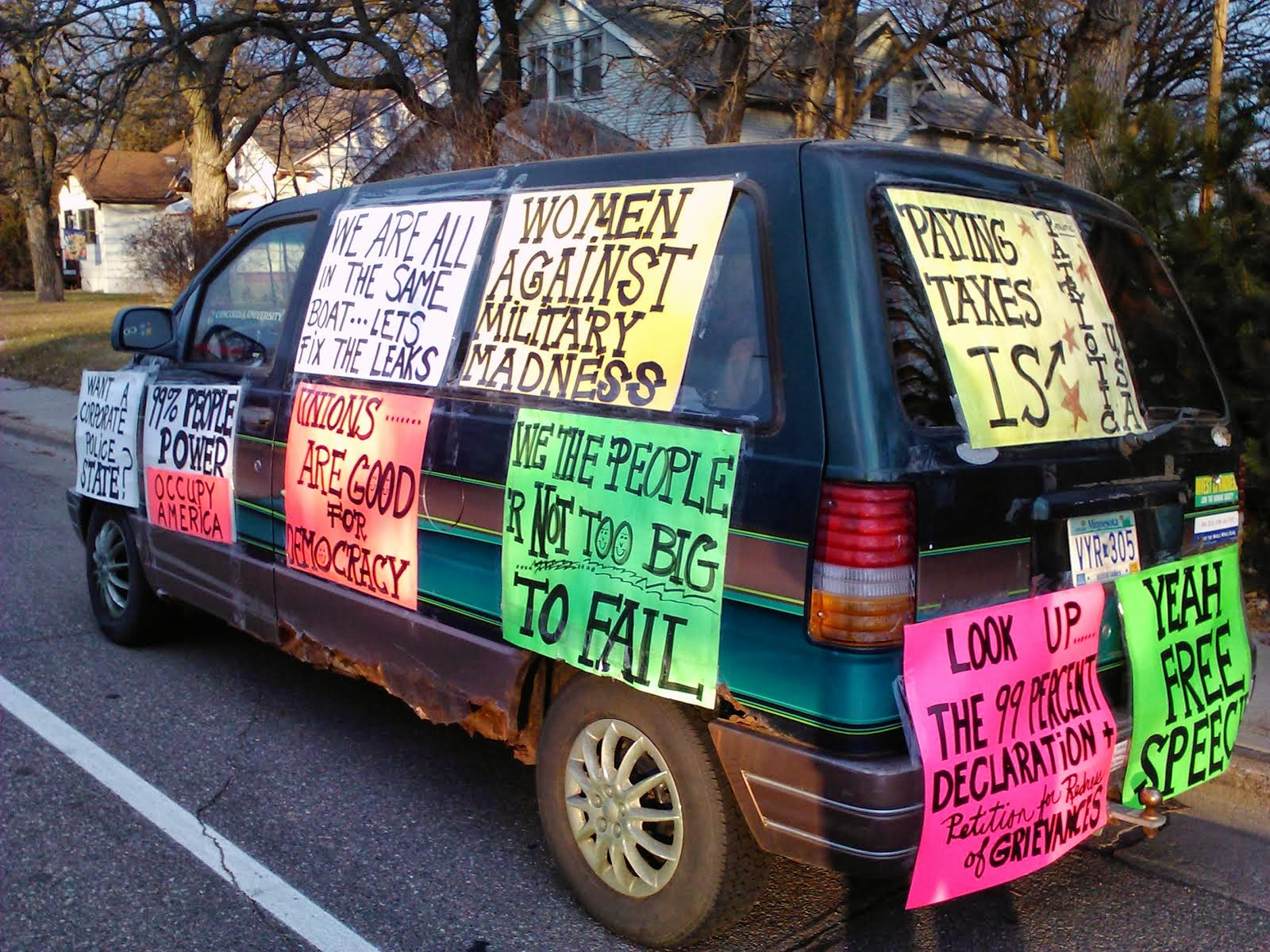 van decked out with signs after told to remove from yard