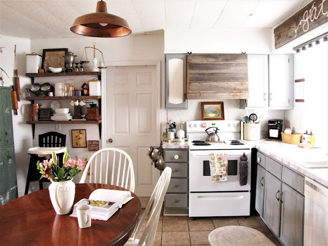 open shelving with lockers for kitchen organization