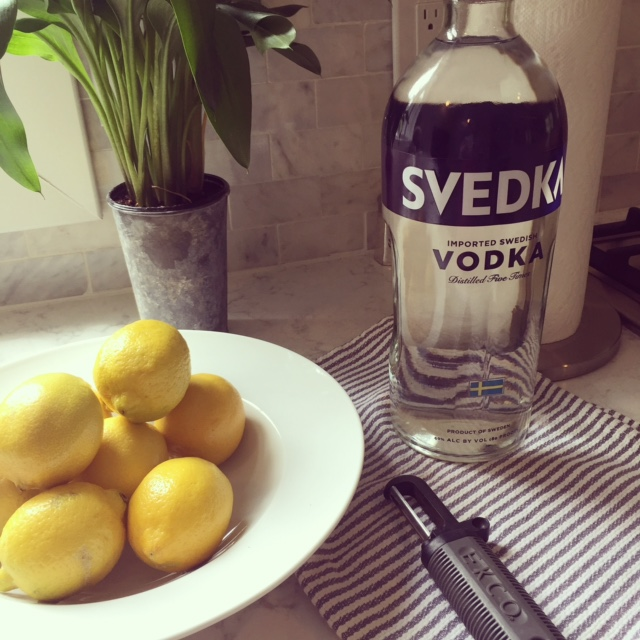 Lemons and vodka for limoncello - Hello Lovely Studio
