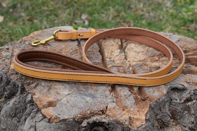 Leather rein leash with padded handle loop made in light brown leather with solid brass snap-hook