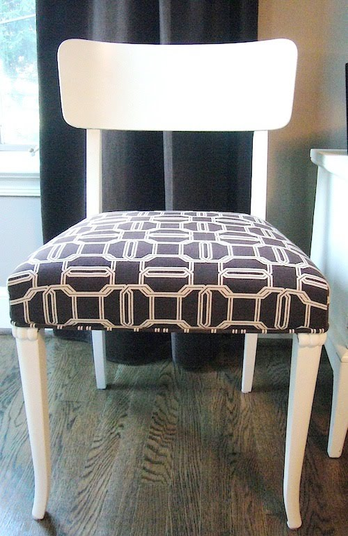 Dining room chair painted bright white and upholstered with Kelly Wearstler's brown Emerald Cut fabric on the seat
