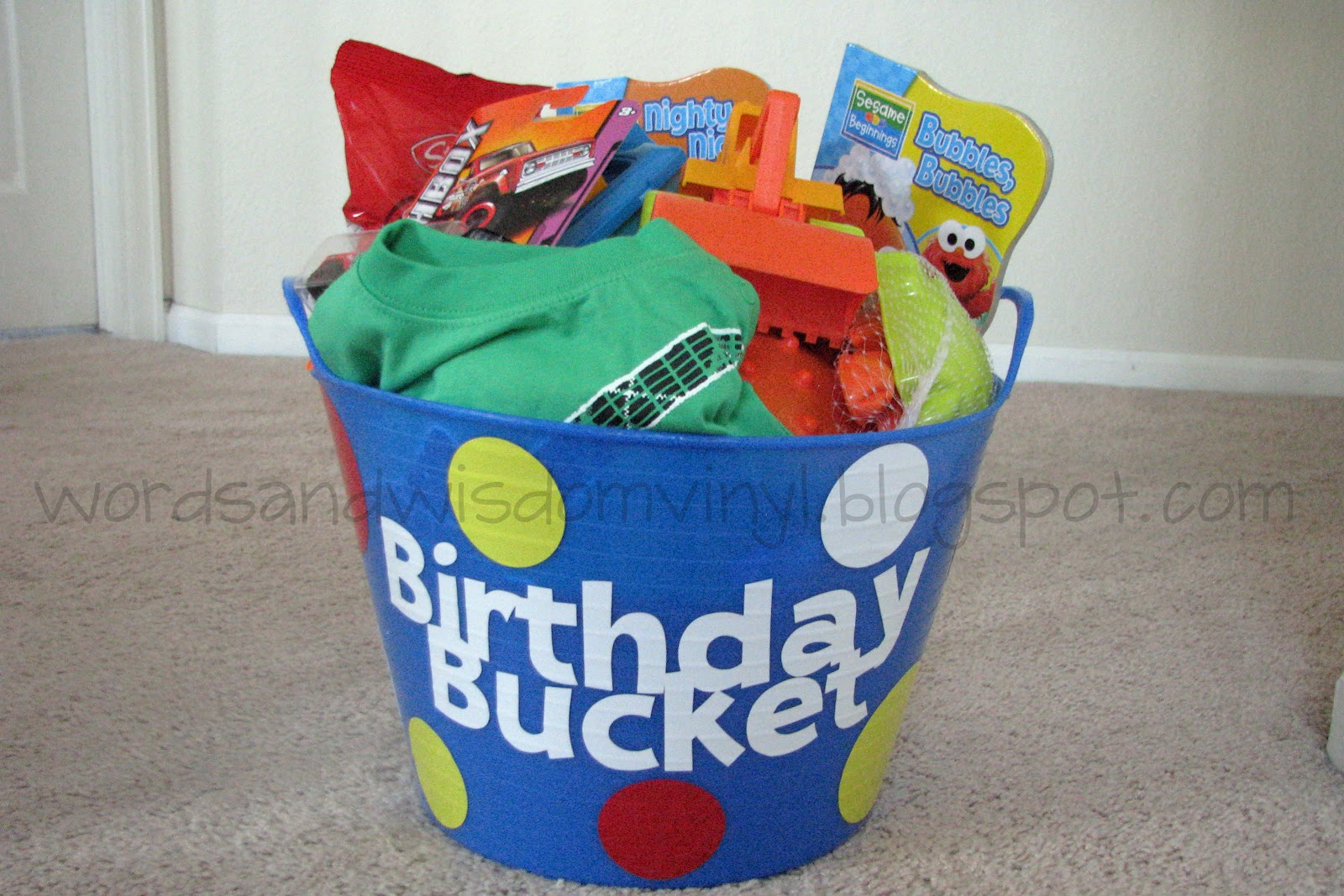 His Bucket Included A New Outfit Some Fun Bath Toys Books Matchbox Car Animal Crackers And Big Spikey Ball