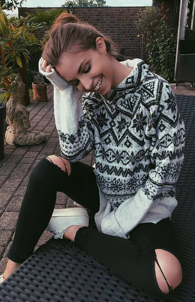 printed sweater + sneakers + black rips