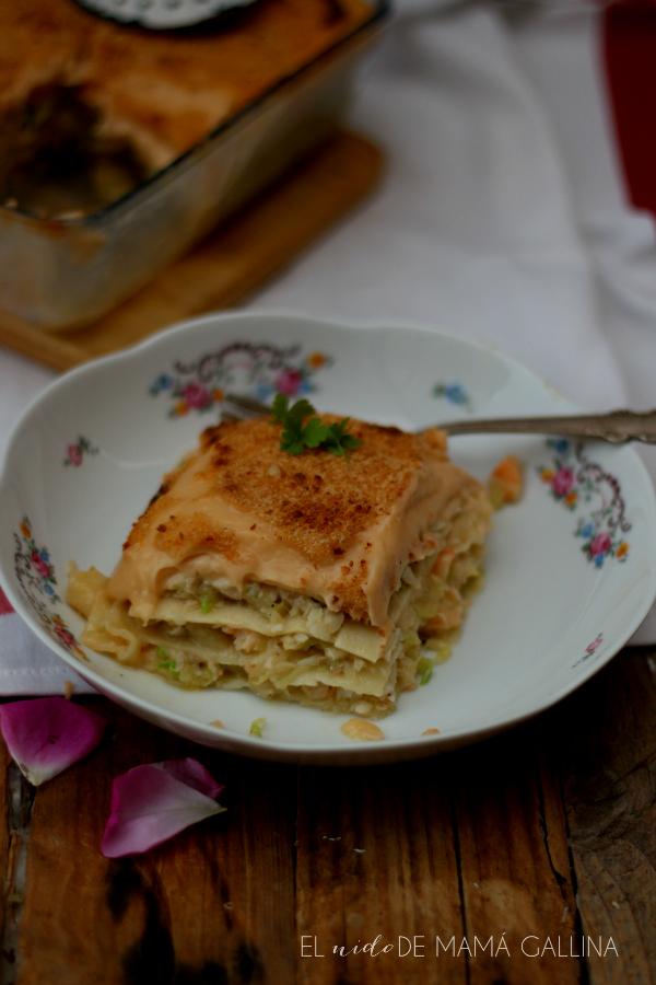 ración de lasana de verduras con pescado, langostinos, merluza