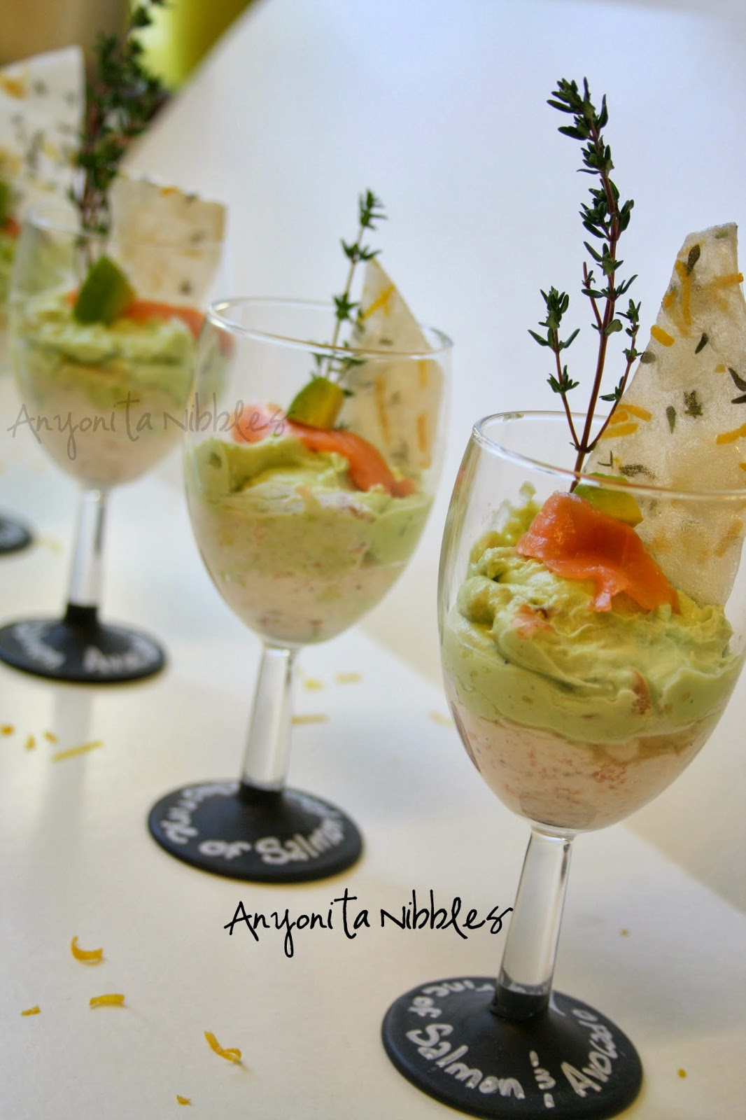 Smoked salmon mousse with avocado guacamole and lemon and thyme paper