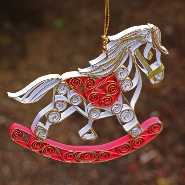 white, red, and gold quilled rocking horse tree ornament