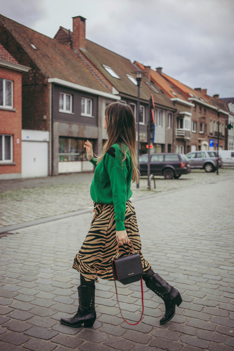 Outfit: animal print wrap skirt and cowboy boots