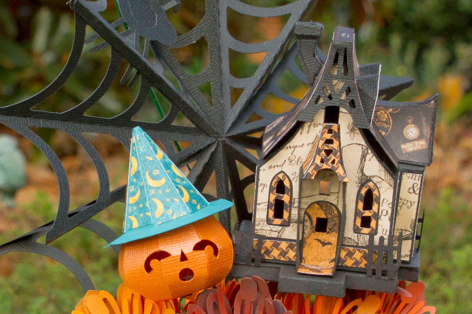 Close up of witch house and pumpkin