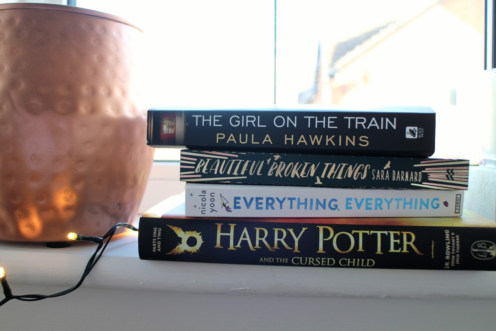 Books on shelf - rom com, classics, harry potter