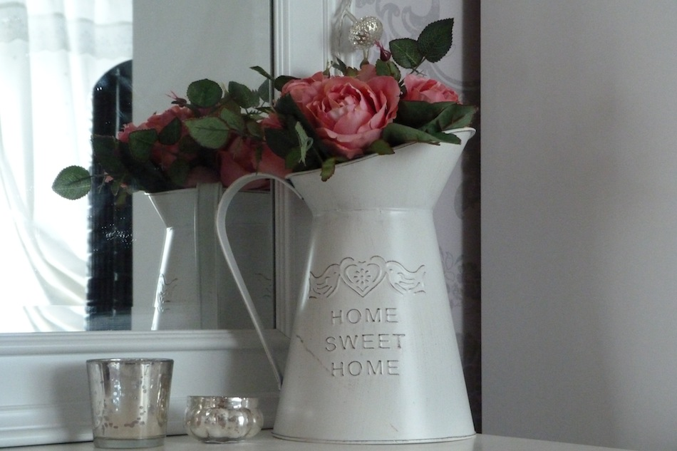 an image of a white metal jug with home sweet home on
