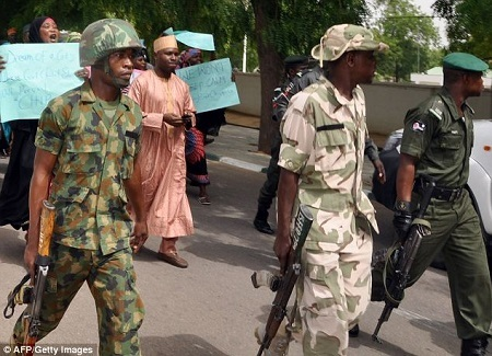Pandemonium as Soldiers Storm Delta Community to Flog and Boot Old Protesting Women