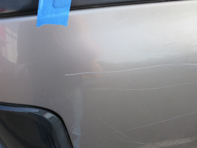 Vandalized Chevy Tahoe before repairs & paint at Almost Everything Auto Body
