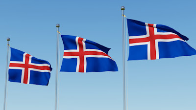 Three Icelandic flags symbolizing the Atlantic Ocean, Scandinavian Christianity and the country's fiery volcanoes