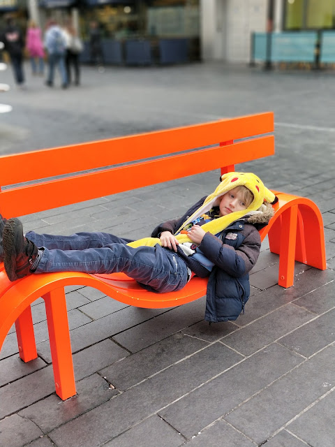 child with ASD on quirky bench in London