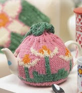 http://www.letsknit.co.uk/free-knitting-patterns/flower_teacosy_cushion