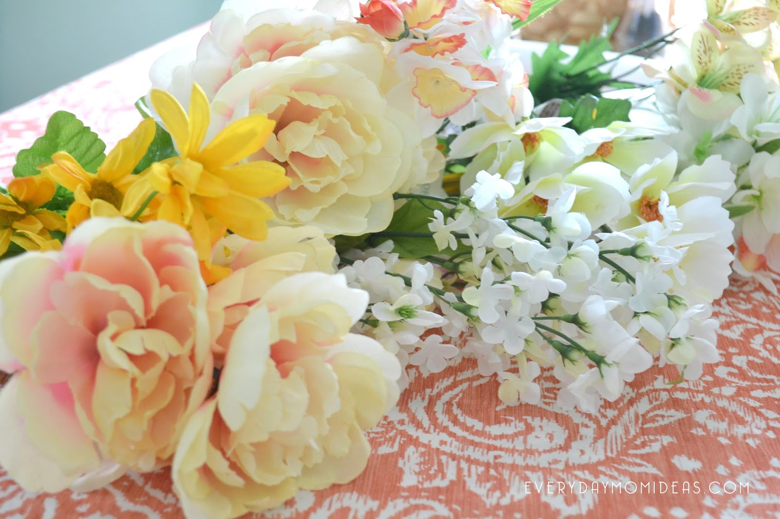 Diy floral baby mobil chandelier full tutorial everyday mom ideas i was surprised at how many flowers there were to choose from at the dollar store i was planning on buying my fake flowers elsewhere thinking i would not arubaitofo Image collections
