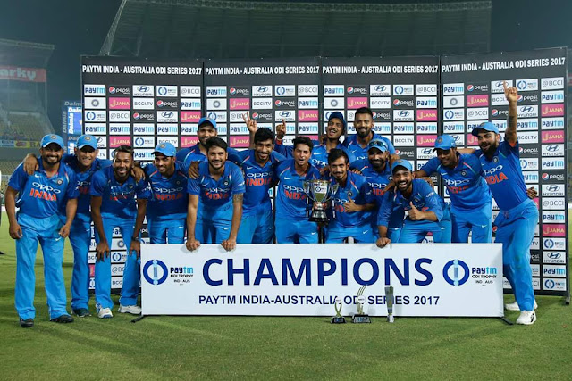 Indian cricket team with the trophy