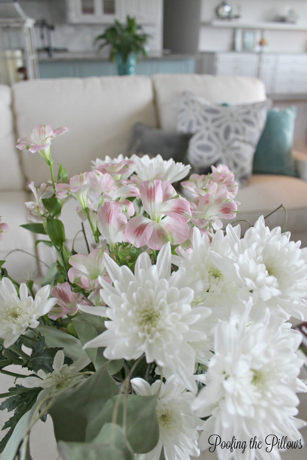 fresh flowers and pillows for fall decorating