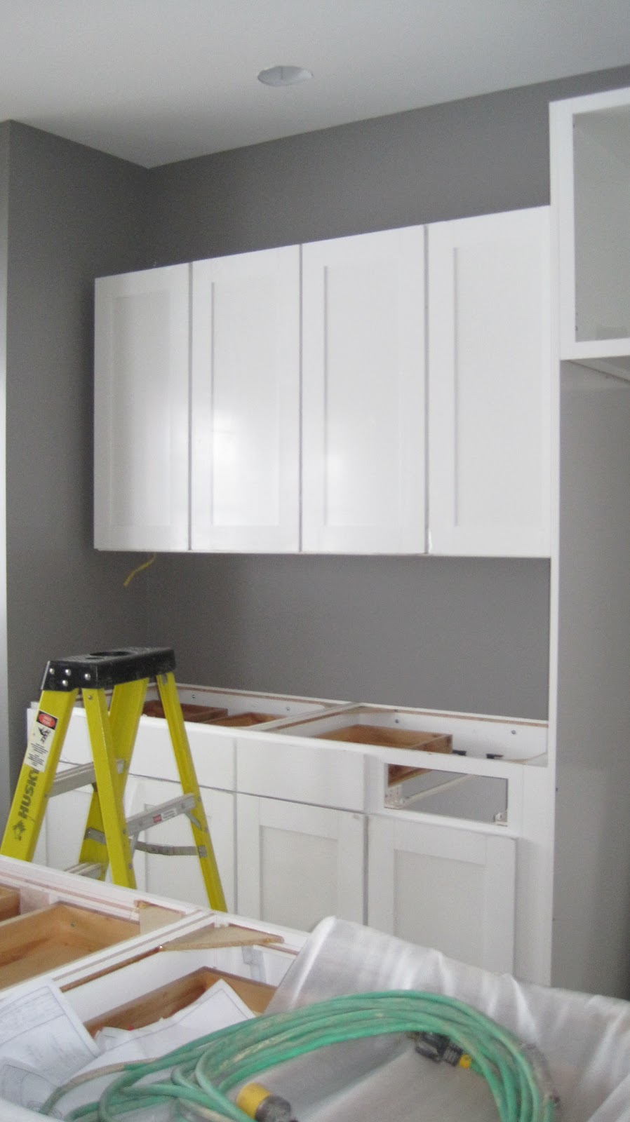I married a tree hugger kitchen is in columns are up - Grey and white walls ...