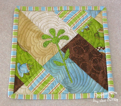 Applique mug rug