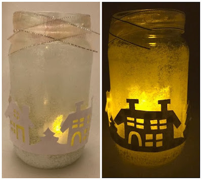 A winter lantern craft lit up with candle