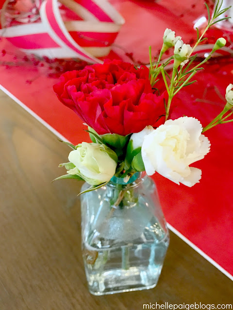 Individual flower arrangements at each place setting.