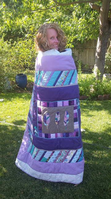 Aqua and purple feather round robin quilt