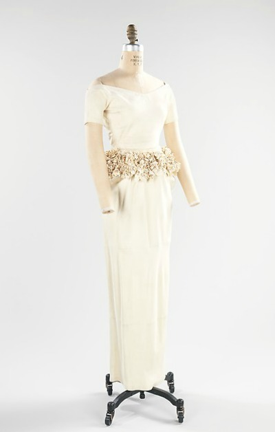 White leather Bonnie Cashin wedding dress with flowered bodice on display on dress stand