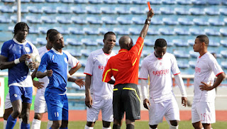 Nigerian Referee Giving Red Card