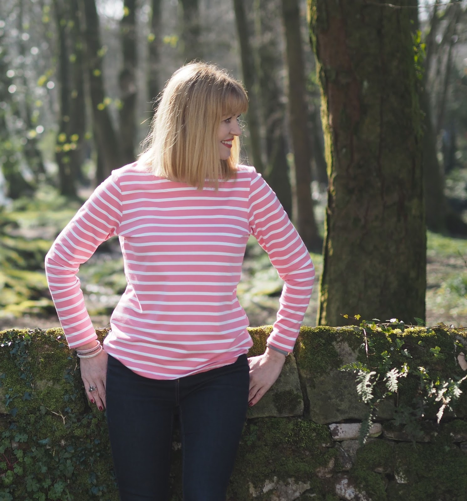 Close up shot of pink and white striped breton top by Tulchan with skinny jeans and silver Superga pumps