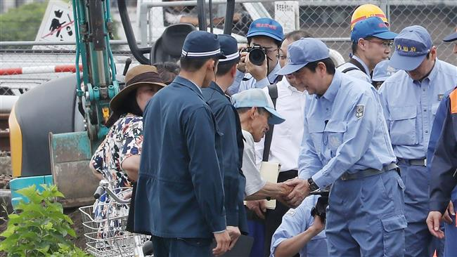 Japanese Prime Minister Shinzo Abe promises to help flood victims as death toll up to 28