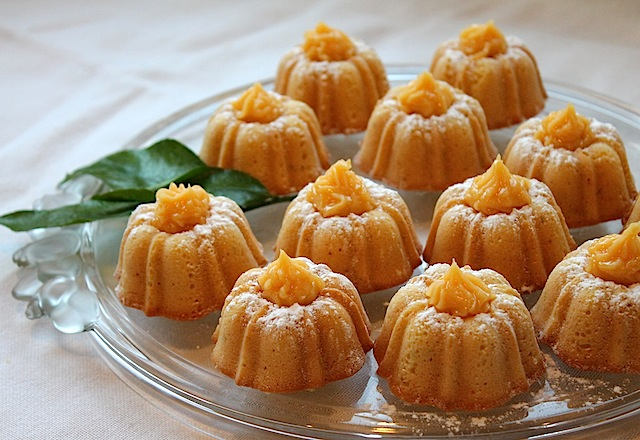 Food Lust People Love: Citrus Lust Mini Bundt Cakes are topped with homemade lemon curd for a gorgeous and deliciously sweet and tart dessert that will delight fancy guests and family alike.