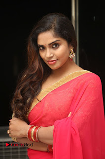 Actress Karunya Chowdary Pictures in Red Saree at Neerajanam Audio Launch  0009.JPG
