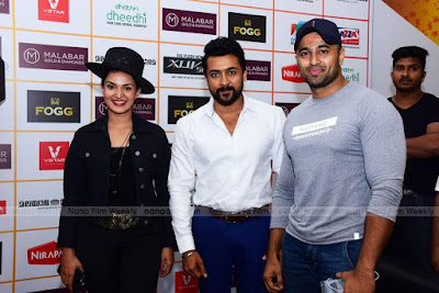 Suriya-With-Honey-Rose-at-Amma-Mazhavillu-Film-Awards-HD-Photos