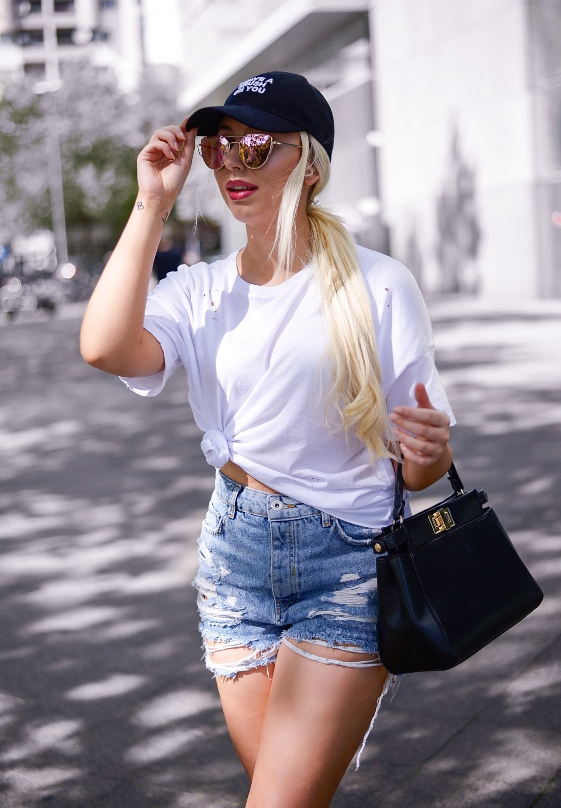 high waisted denim shorts_black cap_white ripped tee
