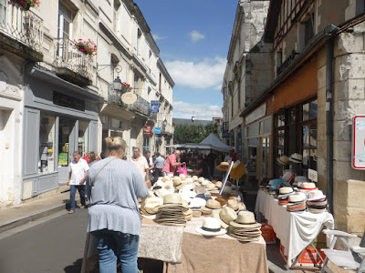 hats for sale at stall at Loches market in the Loire Valley