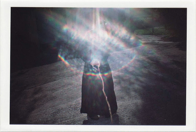 dirty photos - time - cretan landscape photo of orthodox priest and lens flare