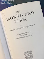 On Growth and Form, by D'Arcy Thompson, superimposed on Intermediate Physics for Medicine and Biology.