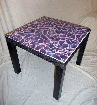 cubierta de mesa decorada con Cds reciclados
