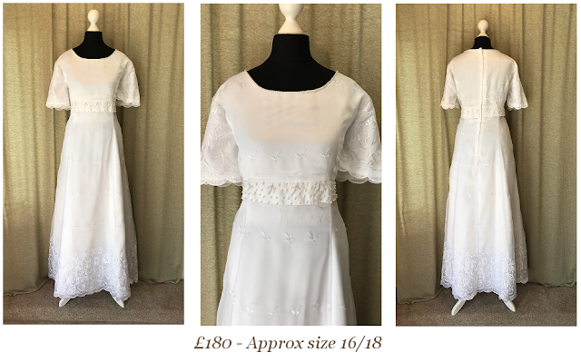 embroidered lace short sleeve vintage wedding dress available at vintage lane bridal boutique in bolton , manchester, lancashire