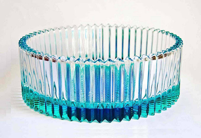 a 1950s glass bowl, fluted, pinked. pleated blue glass