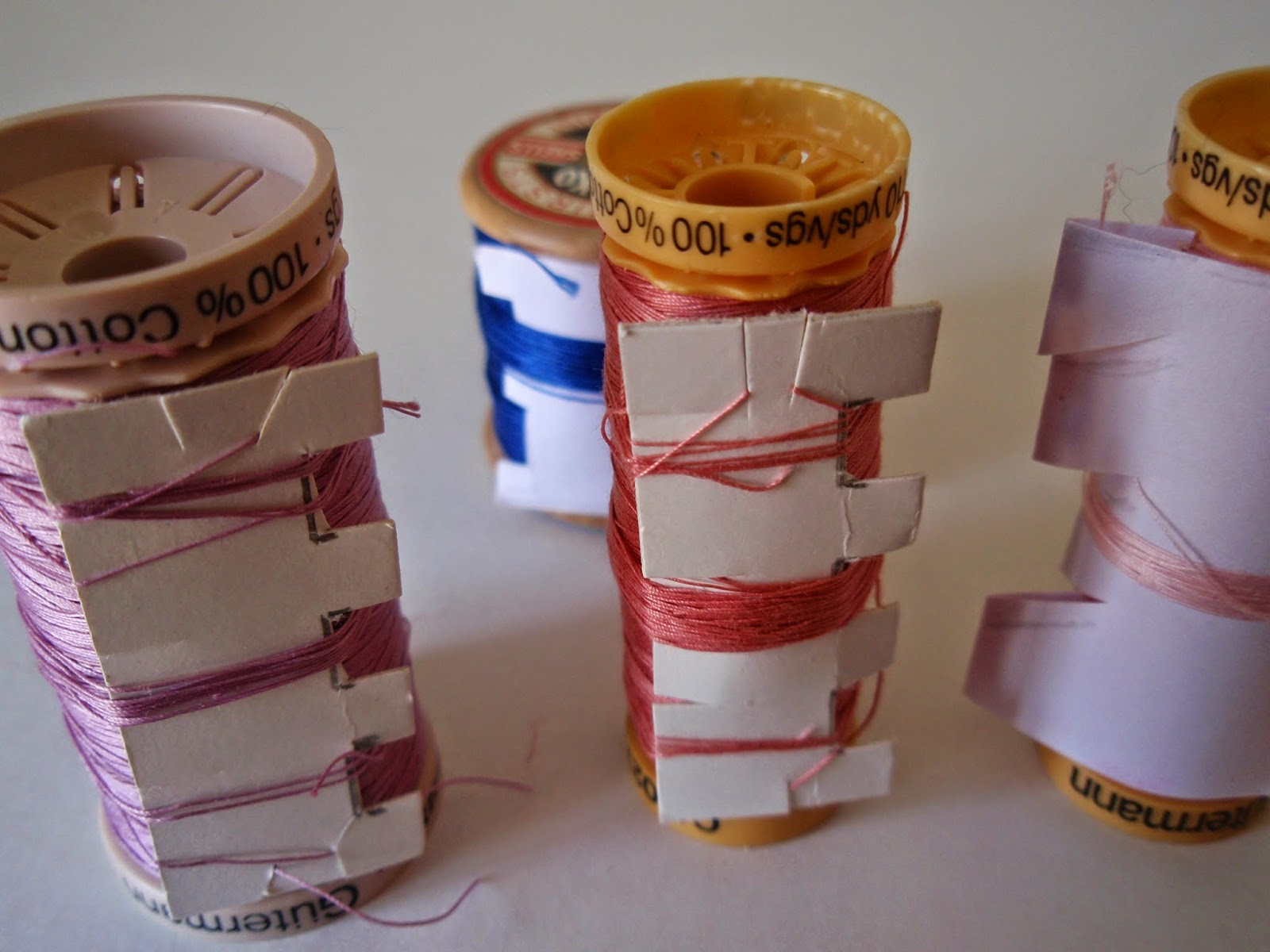 "Cotton reels with ""Tidy"""