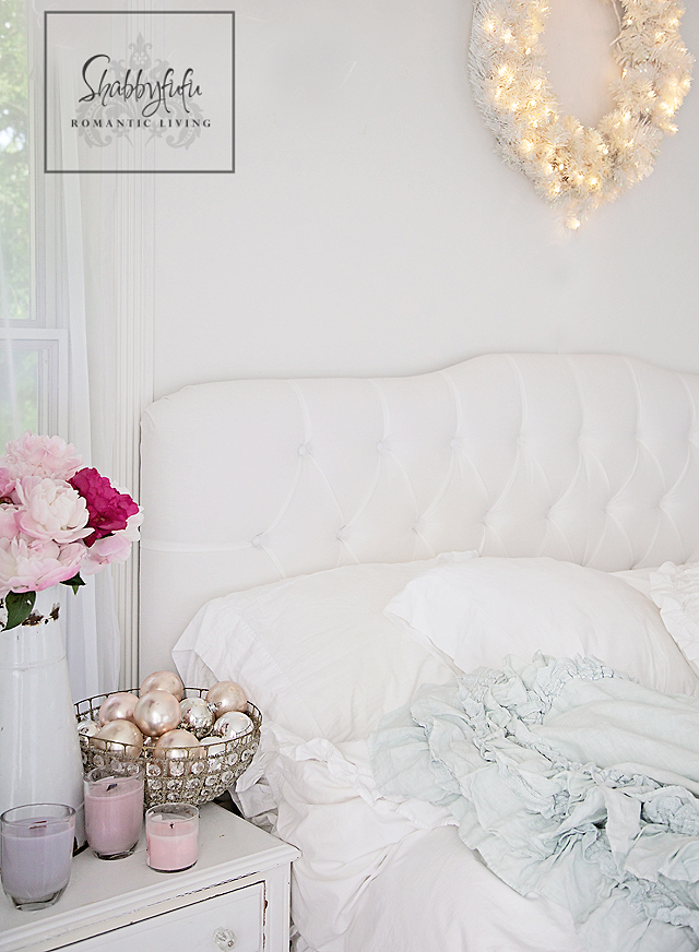 decorating with white - white bed linens make for a romantic setting accented with bright pink flowers and silver globes.