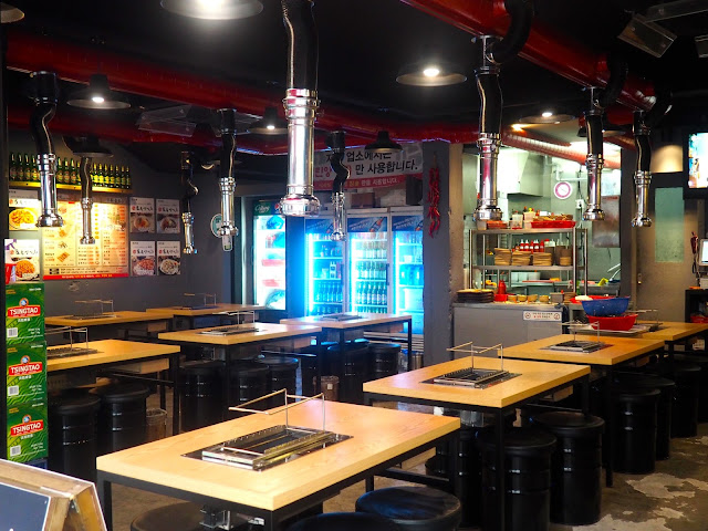 Interior of an empty Korean barbecue restaurant in Seomyeon, Busan, South Korea