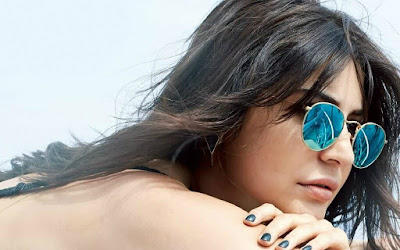 Anushka Sharma not only dress but sunglasses looks cool too.