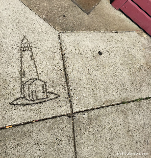 Lighthouse in the cement sidewalks of Newport