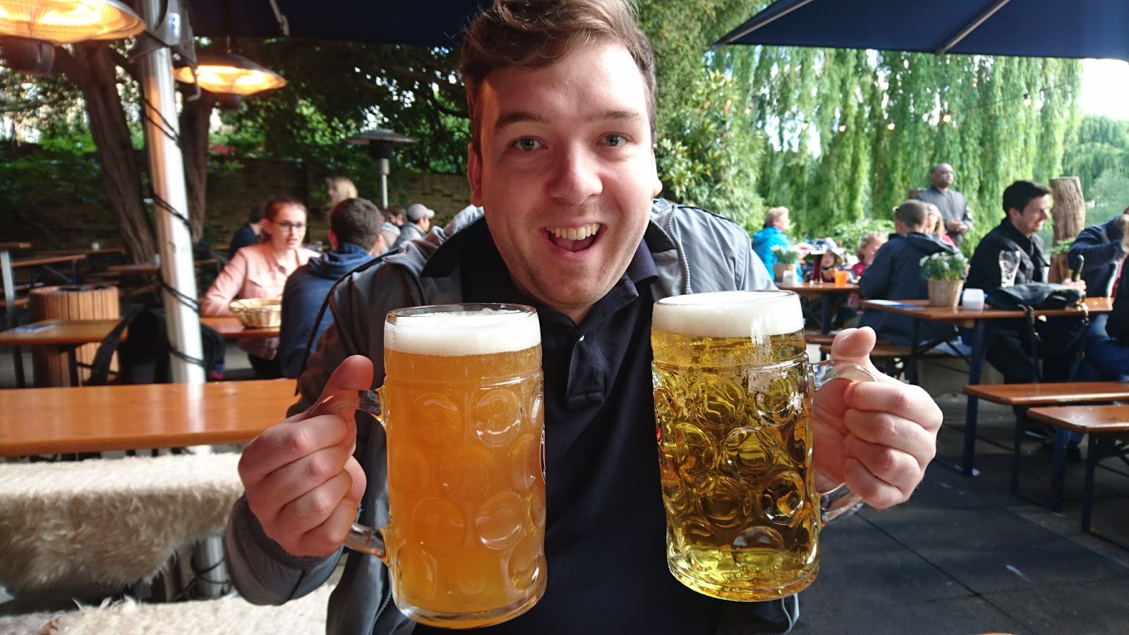 Man holding drinks
