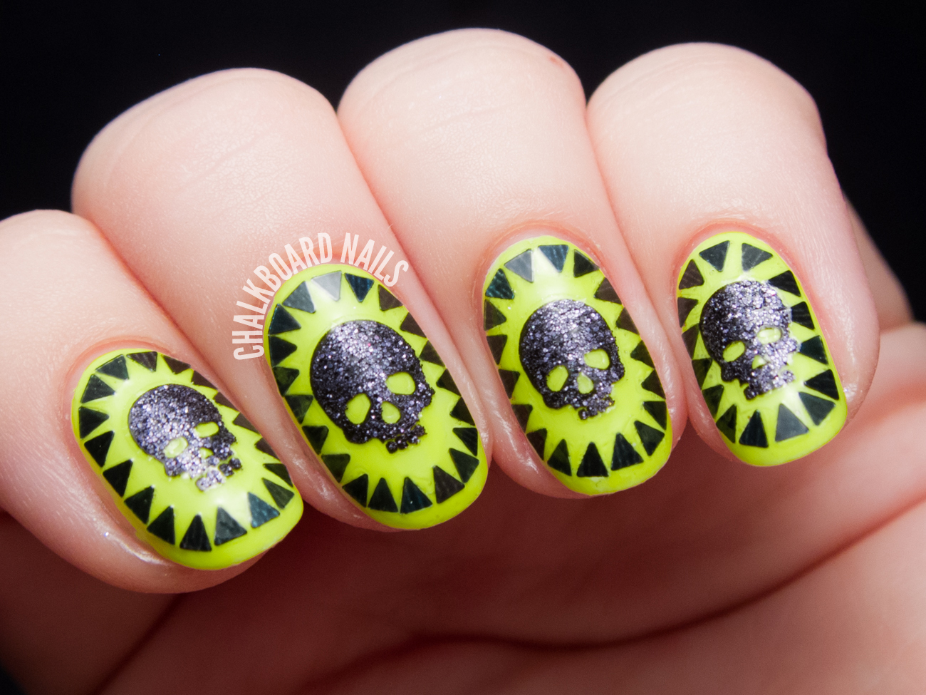 Glittery skull cameo nail art by @chalkboardnails